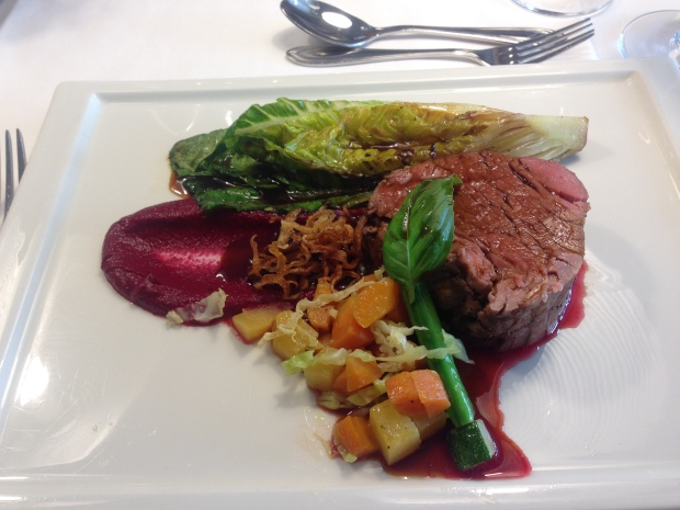 Beef with ox-tail reduction on a beet puree and vegetables