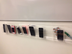Student cell phones stored at the whiteboard to preempt distraction